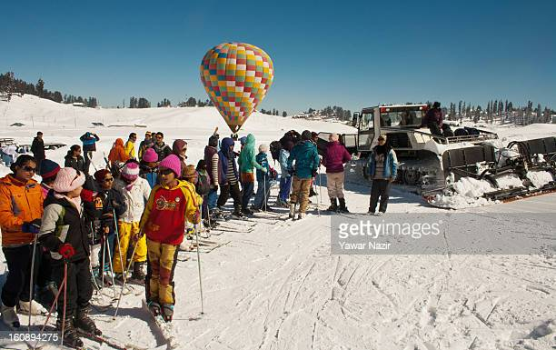 Skiers line up for a beginners lesson on February 07 2013 in Gulmarg 54 km to the west of Srinagar the summer capital of Indianadministered Kashmir...