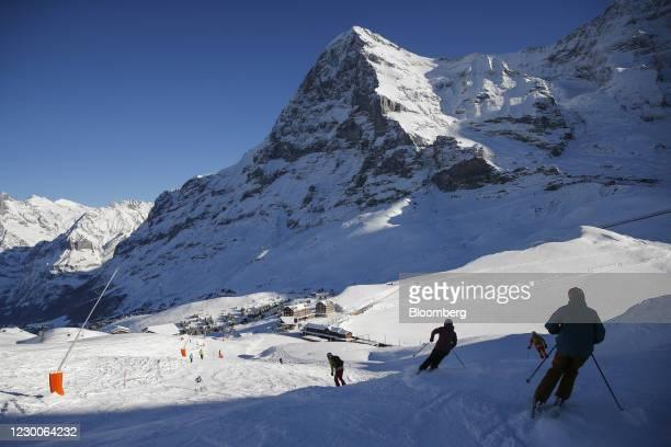 Skiers make their way down a run at the Kleine Scheidegg ski resort in Grindelwald, Switzerland, on Thursday, Dec. 10, 2020. The pandemic has left...