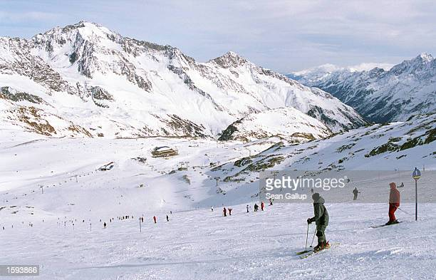 Skiers make their way down a slope on the Stubai Glacier February 7 2001 in Austria Alpine sports are among the small country's biggest tourist...