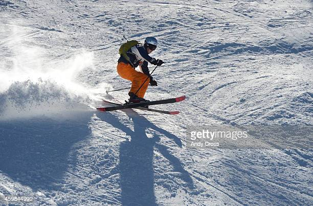 A skiers negotiates a bump on a run underneath the Summit Express lift at the Keystone Resort December 02 2014