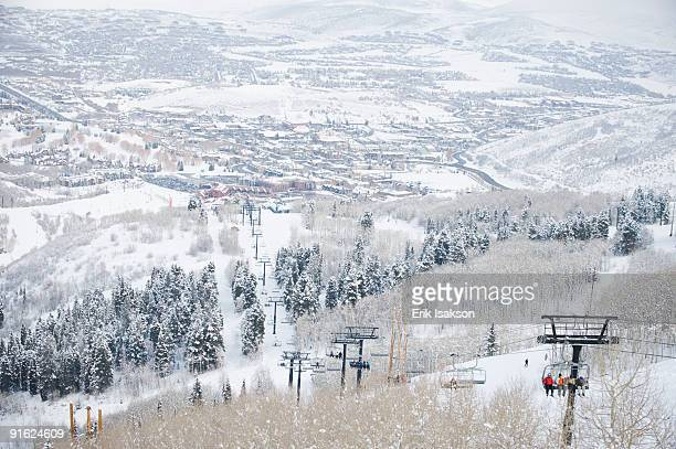 skiers on a ski lift - park city utah stock pictures, royalty-free photos & images