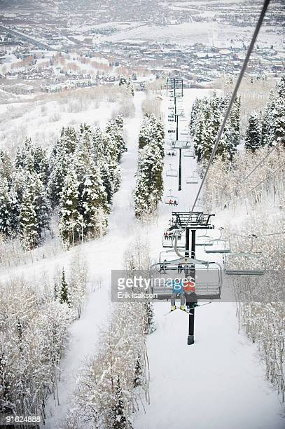 skiers on a ski lift - park city stock pictures, royalty-free photos & images