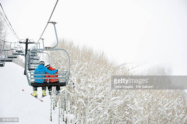 skiers on a ski lift - ski lift stock pictures, royalty-free photos & images