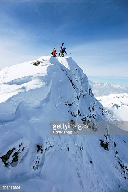 Skiers on mountaintop