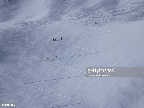Skiers on ski trail on a snowy slope