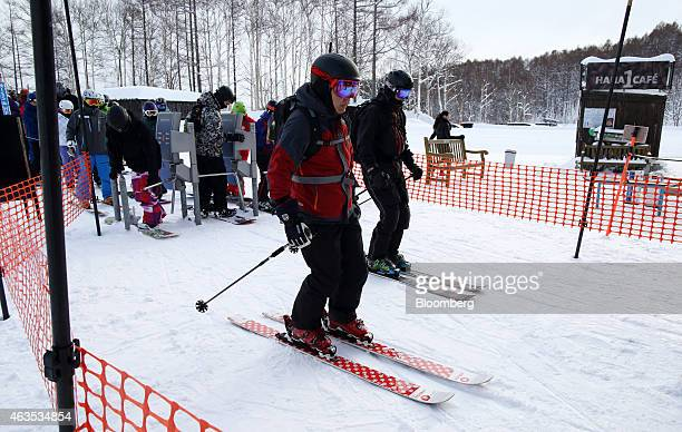 Skiers pass the gate for the lift at the Niseko Hanazono resort operated by Nihon Harmony Resorts KK in Kutchan Hokkaido Japan on Sunday Feb 15 2015...