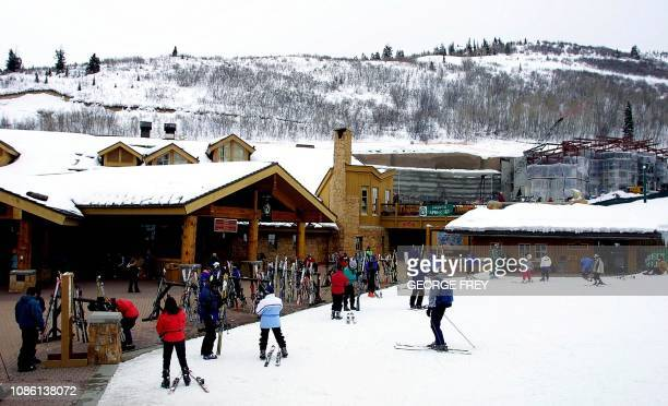 Skiers prepare to go skiing at the base of the Deer Valley Ski Resort 28 February 2001 This will be the site of various ski events for the 2002...