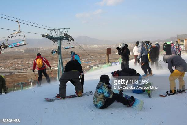 skiers protecting themselves from wind - visual china group stock pictures, royalty-free photos & images