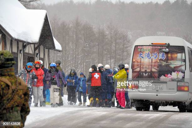 Skiers rescued from the summit by a SelfDefense Force helicopter are seen on January 23 2018 in Kusatsu Gunma Japan KusatsuShirane a 2160meter...