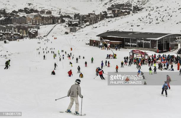 Skiers ride down a slope at Val Thorens in the French Alps on November 24 during the ski station's opening weekend The kickoff of the ski season will...