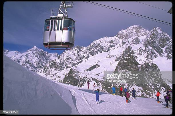 Skiers Ride Mountain Tramways on the Slopes Courmayeur, Italy
