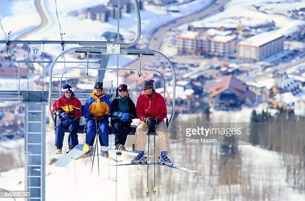 skiers riding on a ski lift - ski holiday - fotografias e filmes do acervo