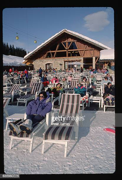 Skiers Sitting on Sunlounges