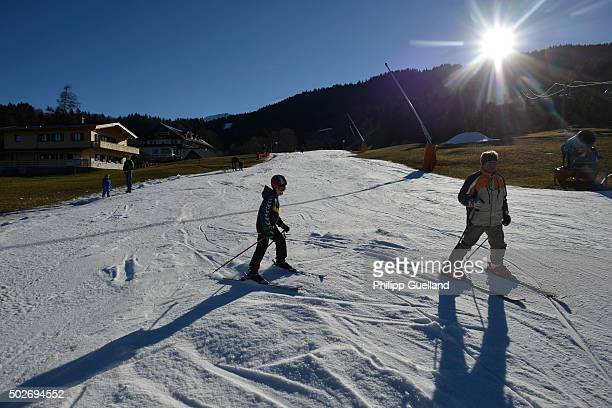 Skiers ski down a slope of manmade snow on a sunny day with temperatures of up to nine degreesCelsius at Garmisch Classic Ski resort in the German...