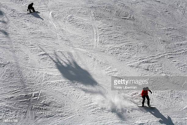 Skiers slide down the Todorka mountain, March 24, 2007 in Bansko, Bulgaria. The most popular ski site in Bulgaria, for Bulgarians and foreigners is...