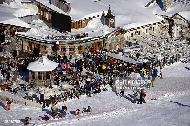 Skiers take a break in the 'La folie douce' restaurant on December 12 in Val d'Isere French Alps Recent snowfalls have encouraged skiers to hit the...