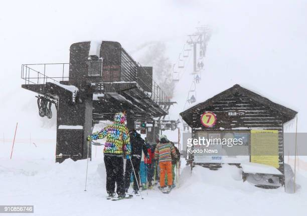 Skiers take a ski lift at Kusatsu Kokusai Ski Resort in Gunma Prefecture on Jan 27 as the Aobayama slopes at the resort reopened the same day Nearby...