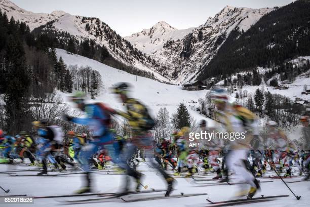 Skiers take the start of the 4th and last stage of the 32nd edition of the Pierra Menta ski mountaineering competition on March 11 2017 in...