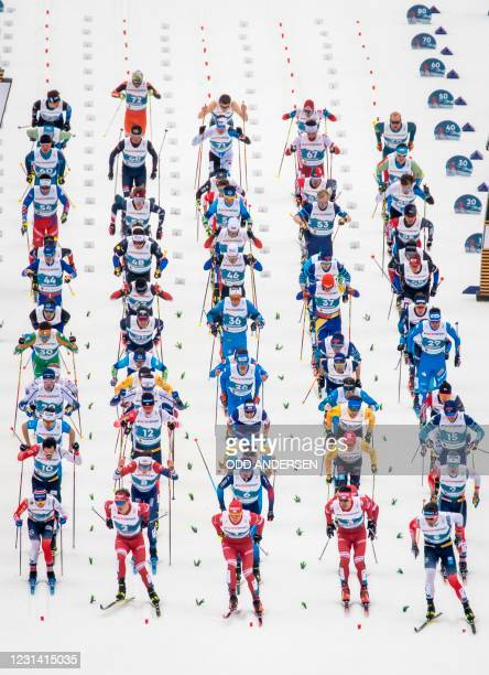 Skiers take the start of the Men's Skiathlon 2x15km event at the FIS Nordic Ski World Championships in Oberstdorf, southern Germany, on February 27,...