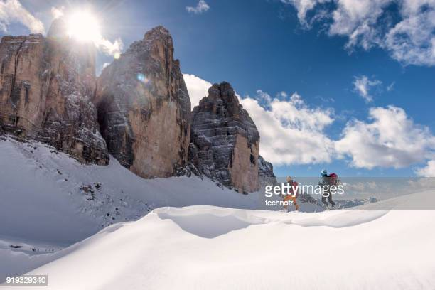 skiers touring around the cime in dolomites, italy - dolomites stock pictures, royalty-free photos & images