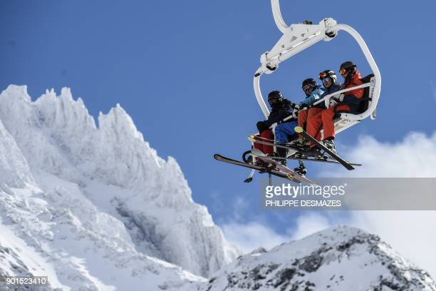 Skiers use a ski lift at Val Thorens ski resort in the French Alps on January 5 2018