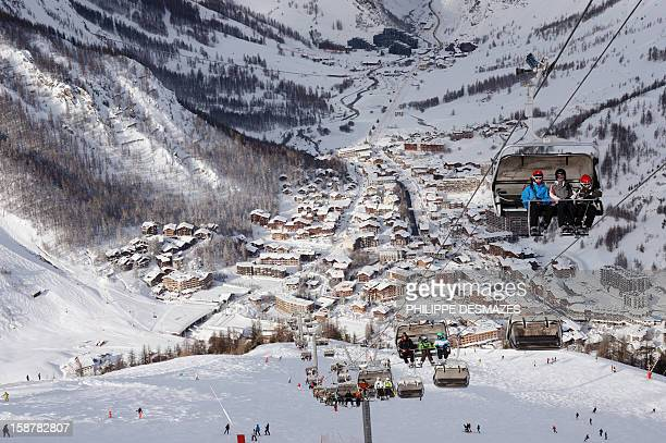 Skiers use a ski lift on December 28 in the French Alps resort of Vald'Isere France's ski slopes are set to be busier than last year as early snow...