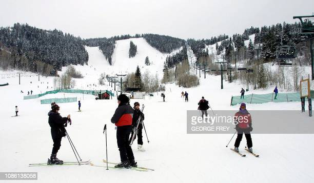 Skiers wait at the base of the Deer Valley Ski Resort 28 February 2001 This will be the site of various ski events for the 2002 Winter Olympics in...