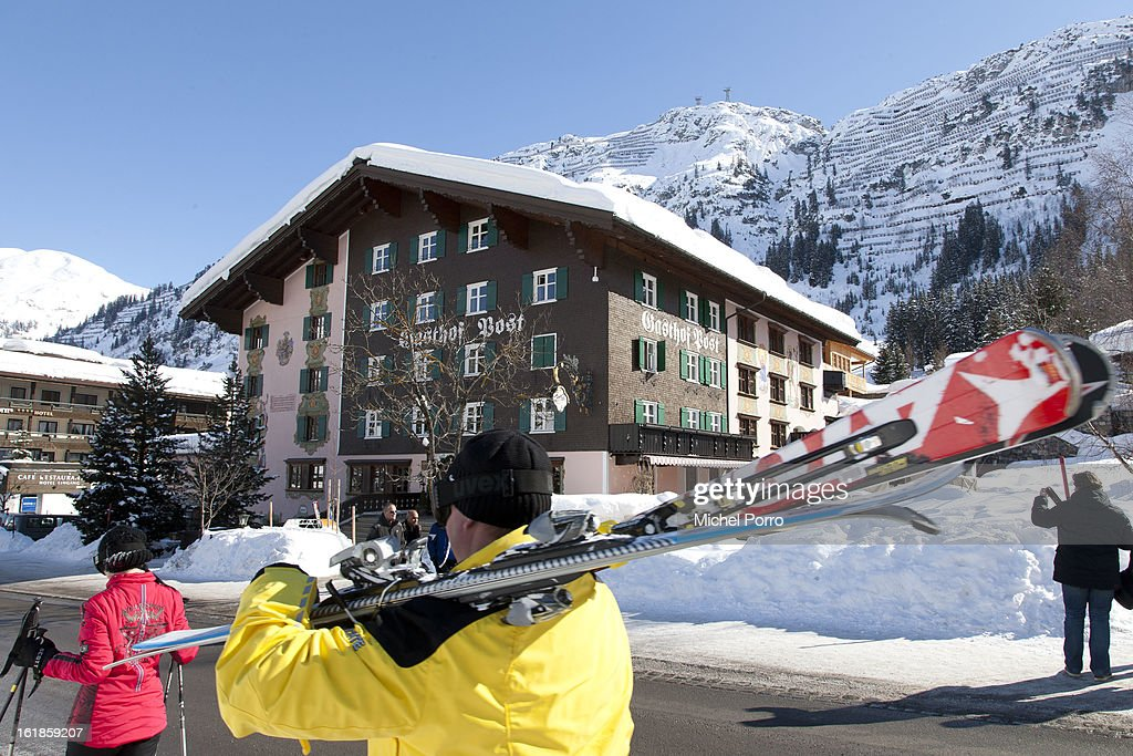 Skiers walk past Hotel Post, the usual holiday residence of Queen Beatrix of The Netherlands and members of the Dutch royal family, on February 17, 2013 in Lech, Austria. A service of prayers was held at Parish Church of St Nicholas in the resort of Lech today, marking the first anniversary of the ski-ing accident that left Prince Friso of The Netherlands critically injured. Prince Friso of Orange-Nassau (44) second son of Queen Beatrix of The Netherlands, was hit by an avalanche while ski-ing off-piste in the resort of Lech, under which he remained buried for 20 minutes. He suffered brain damage due to shortage of oxygen and has remained in a coma since the accident.