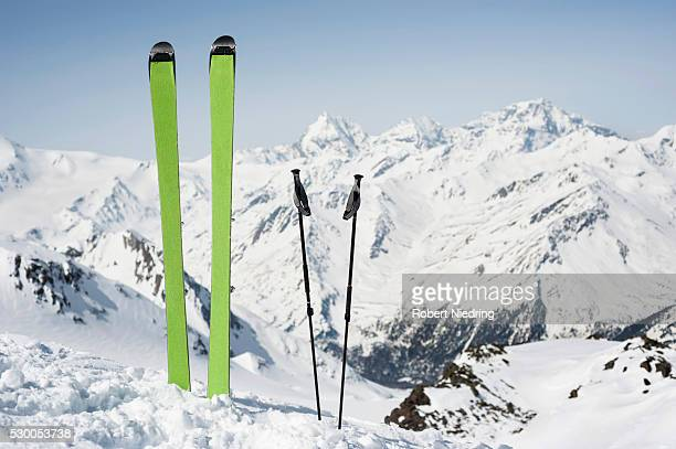 Skies poles Alps mountain peak blue sky nobody