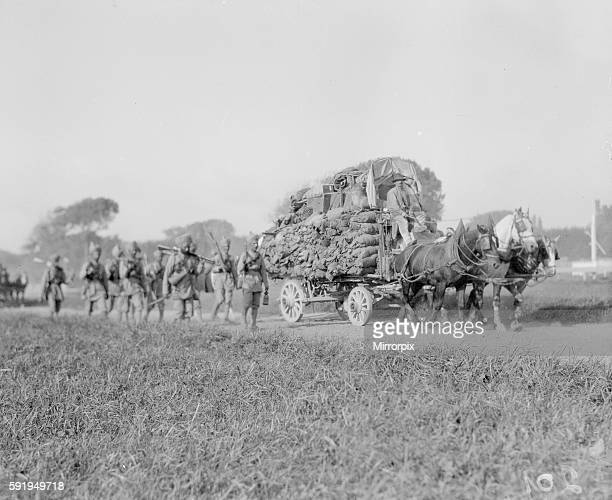 Skih soldiers part of the 3rd Indian Division seen here escorting on of the transports from the docks to their rest camp on the race course at...