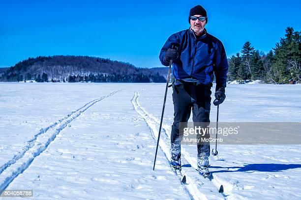 Skiier Crossing Frozen Lake