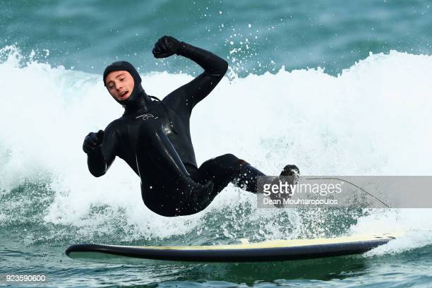Skiier James Matheson of Australia participates in the Aussie Athletes Go Surfing in the cold waters of Yeongjingil Beach on February 24 2018 in...