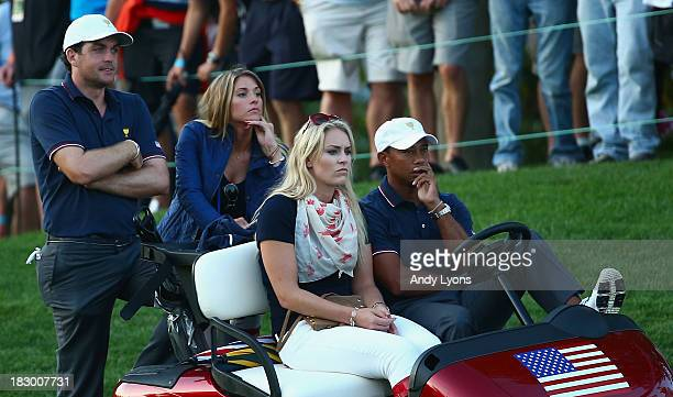 Skiier Lindsey Vonn waits with Tiger Woods alongside Keegan Bradley and Jillian Stacey during the Day One FourBall Matches at the Muirfield Village...