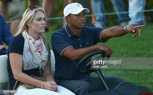 Skiier Lindsey Vonn waits with Tiger Woods during the Day One FourBall Matches at the Muirfield Village Golf Club on October 3 2013 in Dublin Ohio