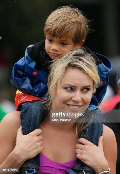 Skiier Lindsey Vonn watches the play of Tiger Woods along with his son Charlie during the third round of the TOUR Championship by CocaCola at East...