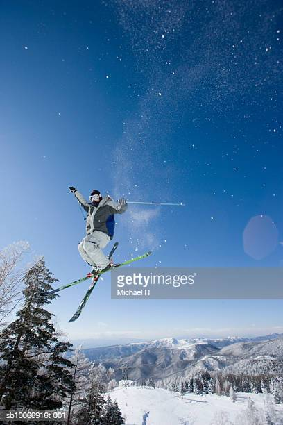 Skiier mid air on slope