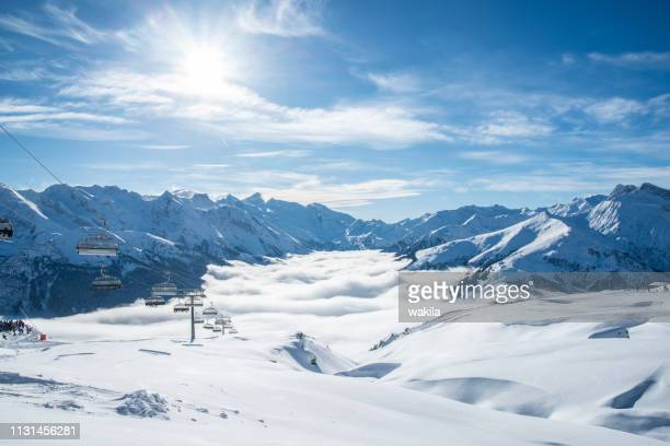 skiiing at zillertal - mountain snow panorama - wolke stock pictures, royalty-free photos & images