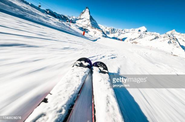 skiing at speed - ski racing stock pictures, royalty-free photos & images