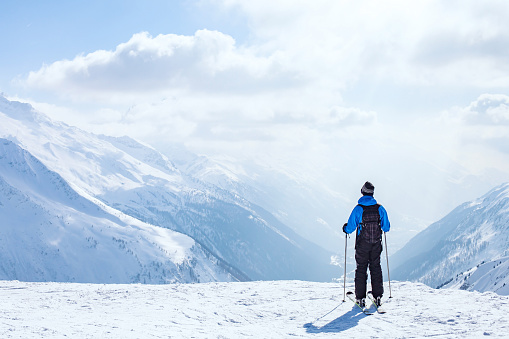skiing background, skier in beautiful mountain landscape 623275510