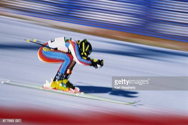 Skiing, downhill skier in action (blurred motion)