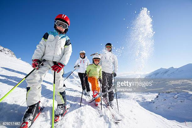 skiing family in mountains