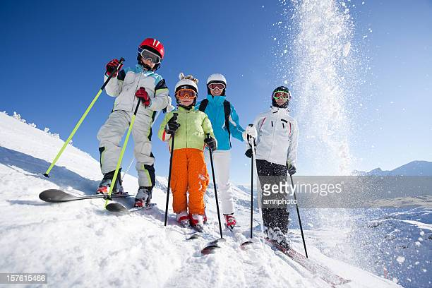 skiing family - ski holiday stock photos and pictures