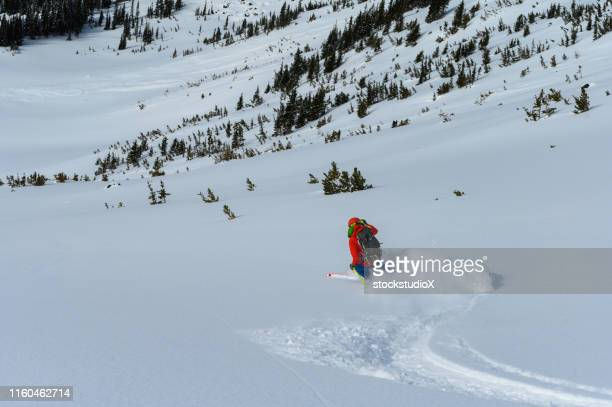 skiing fresh powder in the mountains - turning stock pictures, royalty-free photos & images