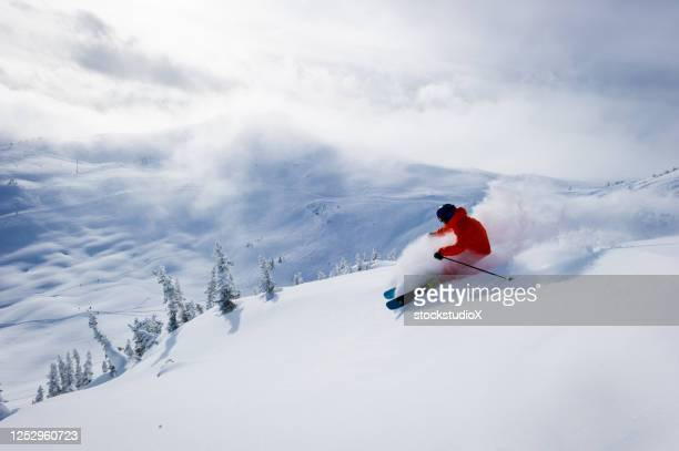 skiing fresh powder on a ski vacation - ski holiday stock pictures, royalty-free photos & images