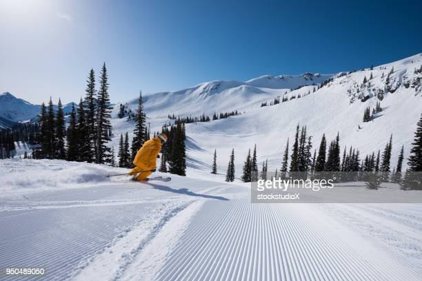 skiing groomed runs on a sunny day - whistler british columbia stock pictures, royalty-free photos & images