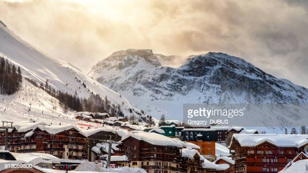 skiing in french ski tourist resort of val d'isere in european alps mountains in winter - savoie stock pictures, royalty-free photos & images