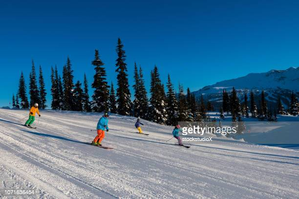 skiing in the mountains on a perfect day - downhill skiing stock pictures, royalty-free photos & images