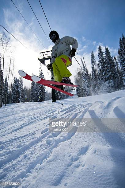 skiing over a mogul - park city utah stock photos and pictures