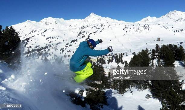 skiing - bluefootage stock pictures, royalty-free photos & images