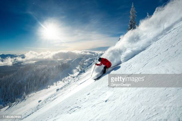 skiing powder - downhill skiing stock pictures, royalty-free photos & images